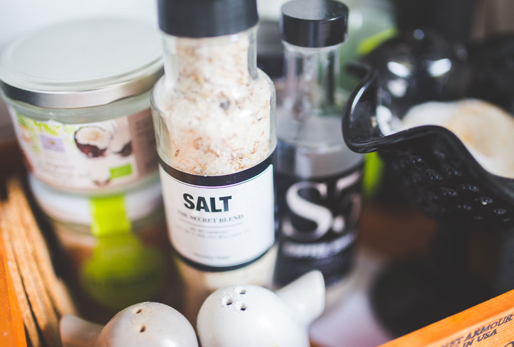 A salt container on dining table